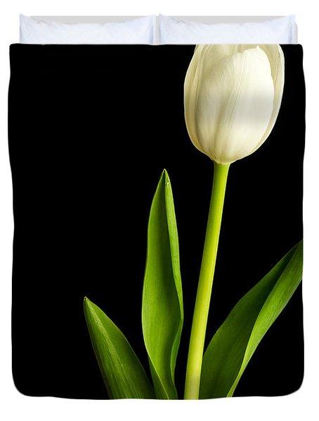 Single White Tulip Over Black Duvet Cover by Edward Fielding
