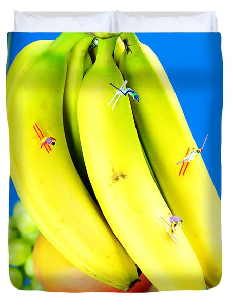 Skiing On Banana Little People On Food Duvet Cover by Paul Ge