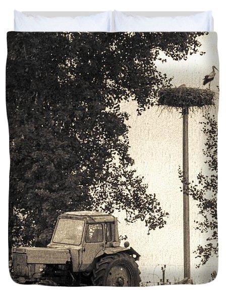 Stork Vs Tractor Duvet Cover by Yevgeni Kacnelson