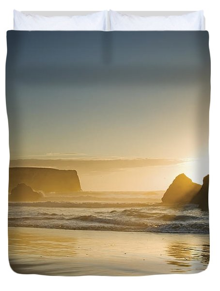 Sunset Behind Offshore Rocks Bandon Duvet Cover by Philippe Widling