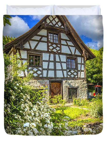 Swiss Chalet in the Garden Duvet Cover by Debra and Dave Vanderlaan