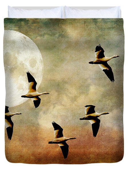 The Flight Of The Snow Geese Duvet Cover by Lois Bryan