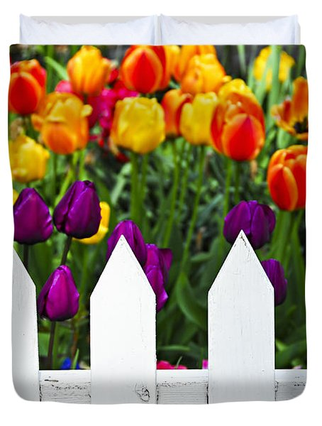 Tulips behind white fence Duvet Cover by Elena Elisseeva