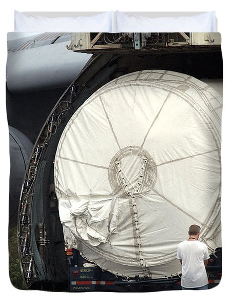 Duvet Cover featuring the photograph Unloading A Titan Ivb Rocket by Science Source