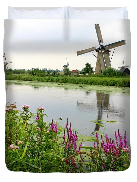 Windmills Of Kinderdijk With Wildflowers Duvet Cover by Carol Groenen