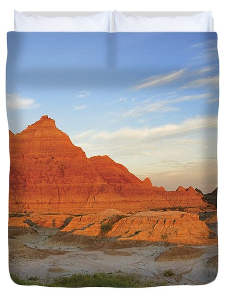 A Red Sunrise Illuminates The Hills In Duvet Cover by Philippe Widling