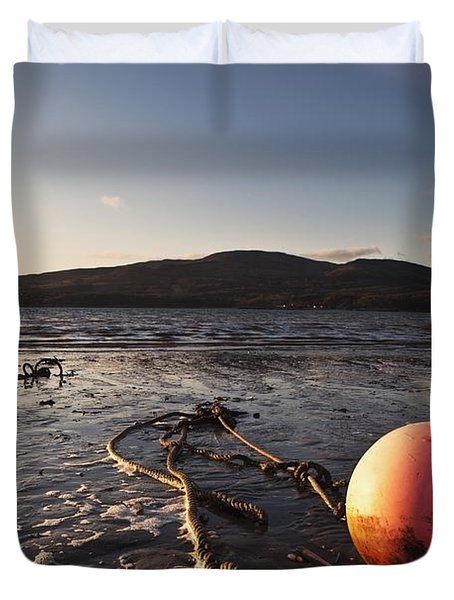 Dumfries, Scotland A Rope Tied To A Duvet Cover by John Short