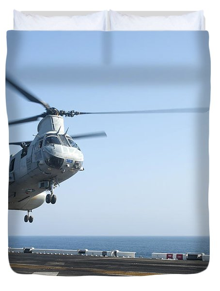 A Ch-46e Sea Knight Helicopter Prepares Duvet Cover by Stocktrek Images