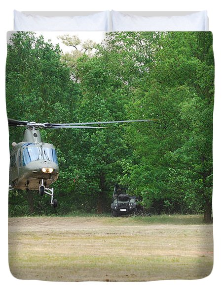 An Agusta A109 Helicopter Duvet Cover by Luc De Jaeger