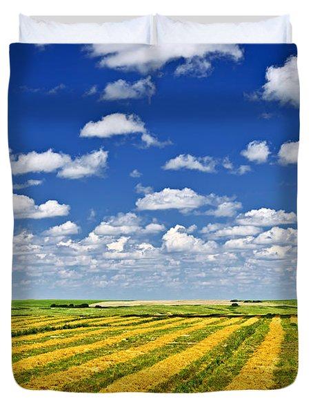 Farm field at harvest in Saskatchewan Duvet Cover by Elena Elisseeva