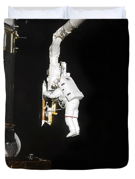 Astronaut Working On The Hubble Space Duvet Cover by Stocktrek Images