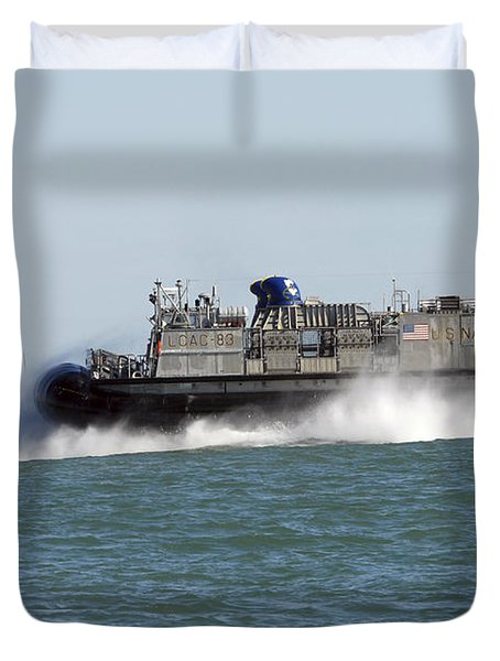 A Landing Craft Air Cushion Prepares Duvet Cover by Stocktrek Images
