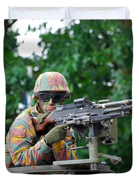 A Belgian Army Soldier Handling Duvet Cover by Luc De Jaeger