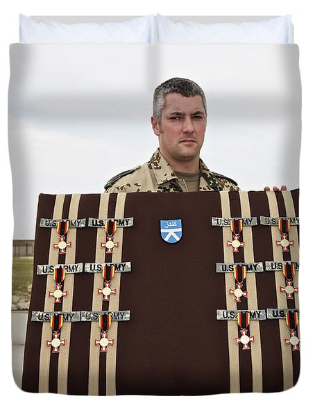 A German Soldier Holds A Display Duvet Cover by Terry Moore