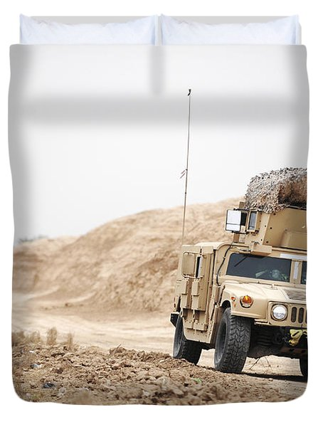A Humvee Conducts Security Duvet Cover by Stocktrek Images