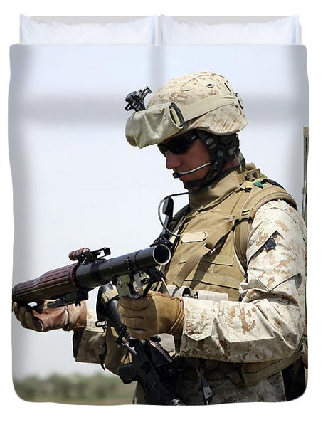 A Marine Looks At A Brand New Duvet Cover by Stocktrek Images