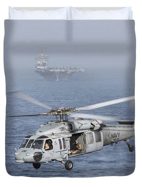 A Mh-60s Knighthawk Conducts A Vertical Duvet Cover by Gert Kromhout