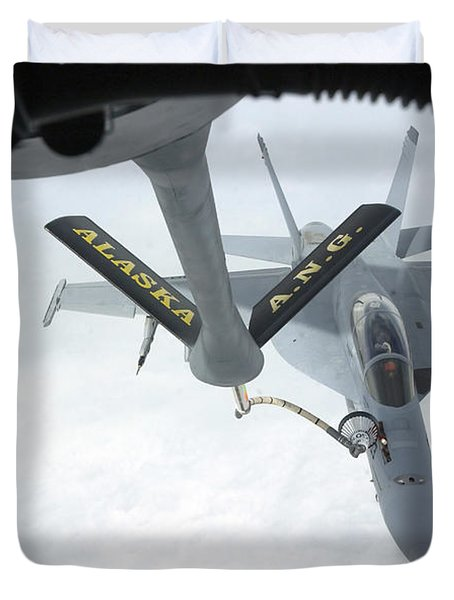 A Navy Fa-18f Super Hornet Is Refueled Duvet Cover by Stocktrek Images