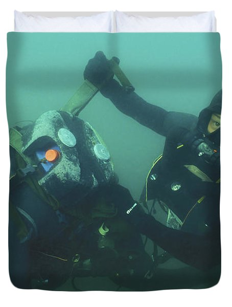 A Navy Seal Combat Swimmer Removes Duvet Cover by Michael Wood