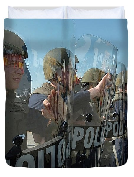 A Riot Control Team Braces Duvet Cover by Stocktrek Images