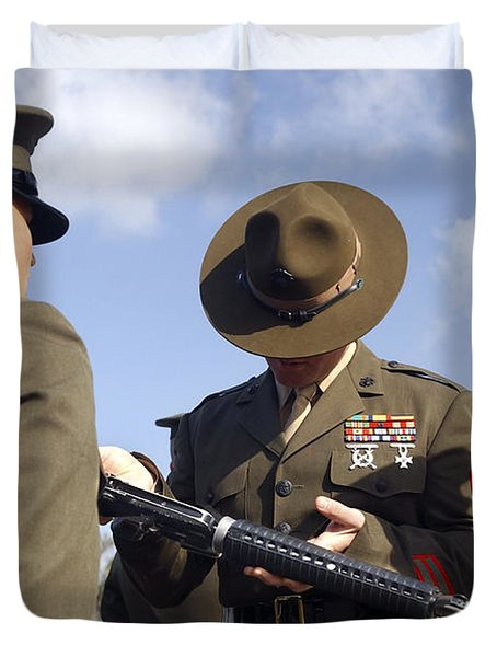 A Senior Drill Instructor Inspects Duvet Cover by Stocktrek Images
