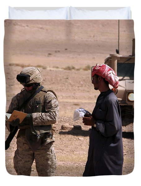 A Soldier Communicates With A Local Duvet Cover by Stocktrek Images