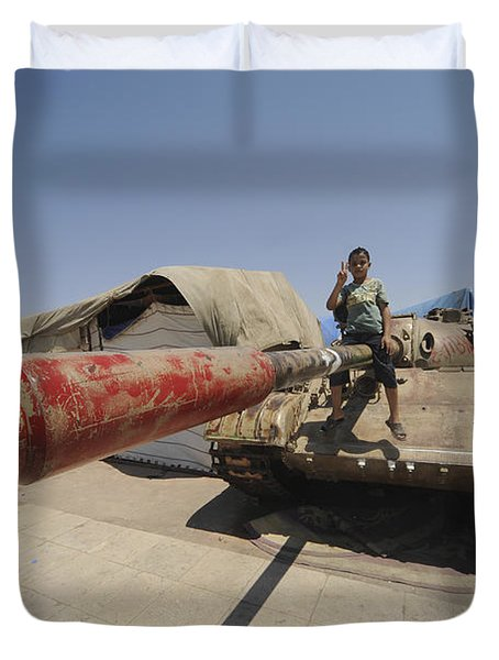 A T-55 Tank With Two Children Playing Duvet Cover by Andrew Chittock