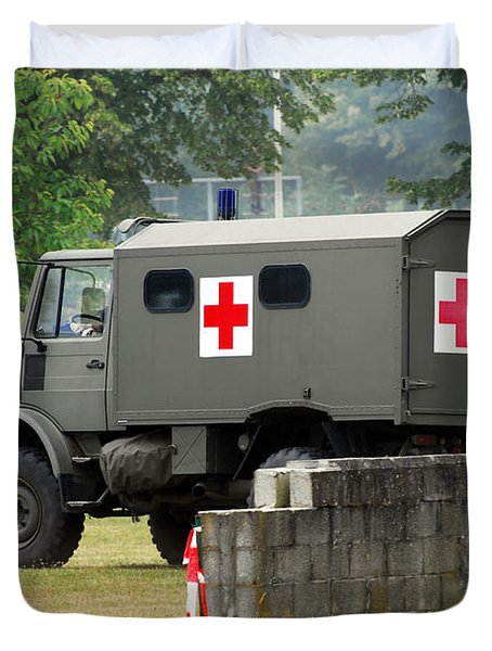 A Unimog In An Ambulance Version In Use Duvet Cover by Luc De Jaeger