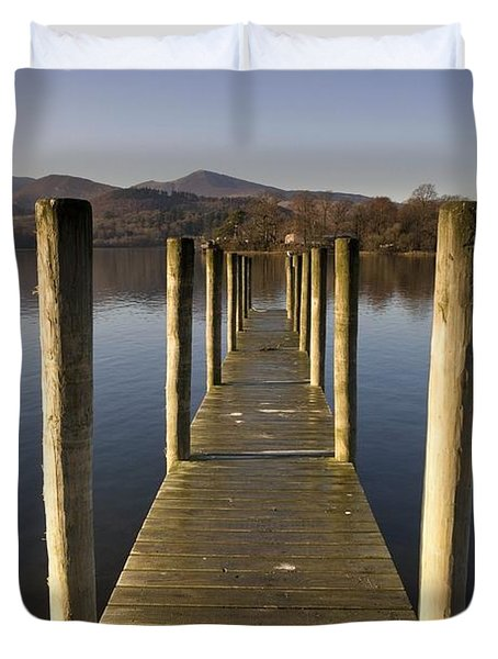 A Wooden Dock Going Into The Lake Duvet Cover by John Short