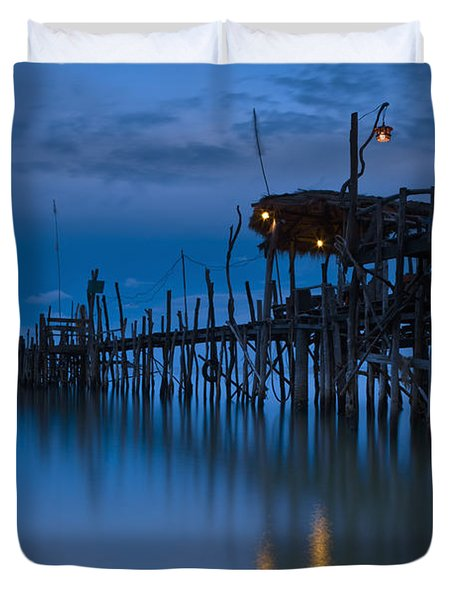A Wooden Pier With Lights On It At Duvet Cover by David DuChemin