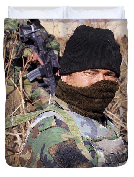An Afghan Commando On Patrol Duvet Cover by Stocktrek Images