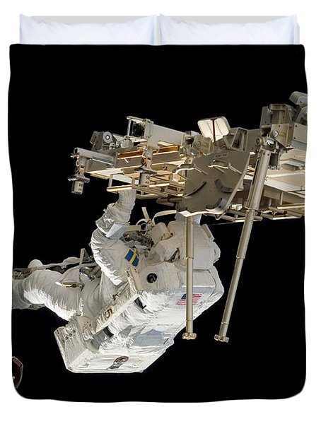 An Astronaut With His Feet Secured Duvet Cover by Stocktrek Images