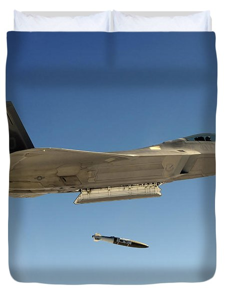 An F-22a Raptor Drops A Gbu-32 Bomb Duvet Cover by Stocktrek Images