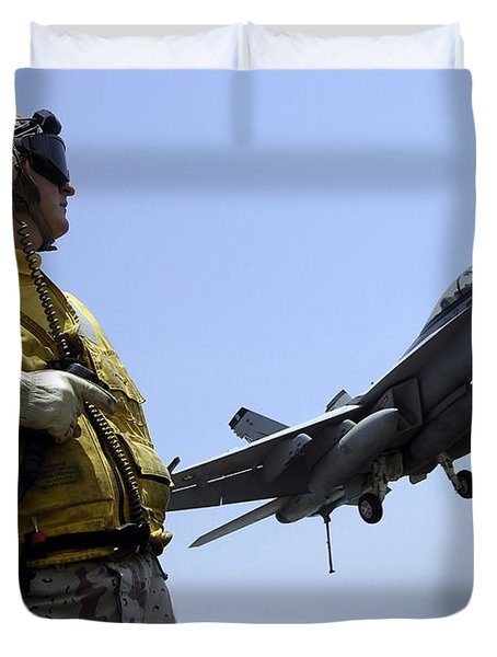 An Officer Observes An Fa-18f Super Duvet Cover by Stocktrek Images