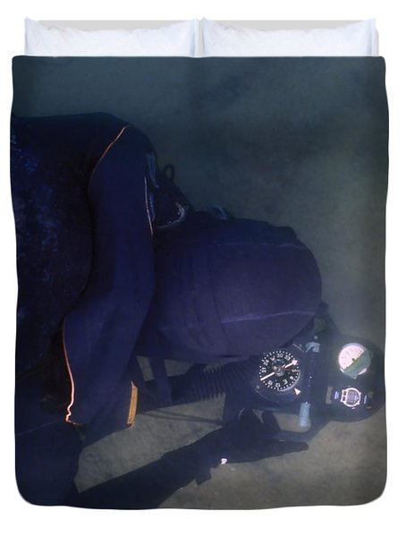 An Over The Shoulder View Of A Navy Duvet Cover by Michael Wood
