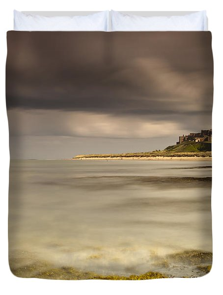 Bamburgh Castle Under A Cloudy Sky Duvet Cover by John Short