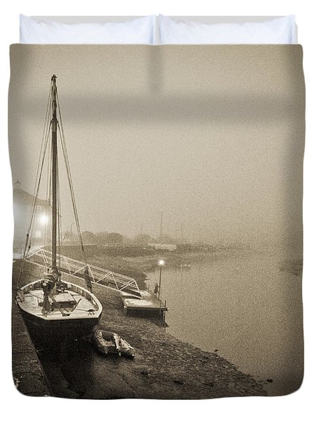 Boat on wintry quay Duvet Cover by Gary Eason
