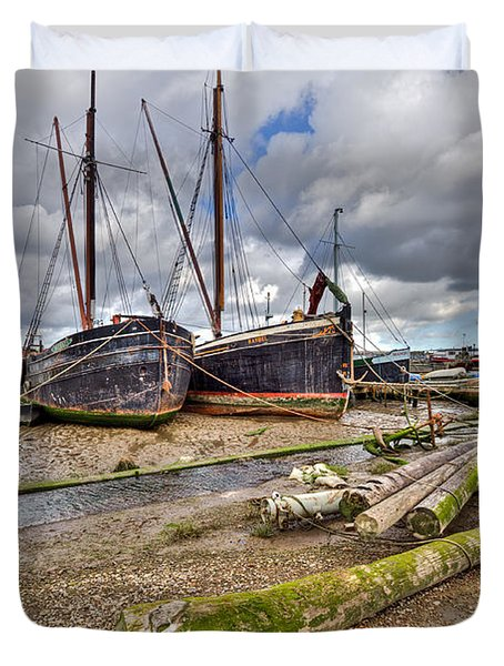 Boats And Logs At Pin Mill Duvet Cover by Gary Eason