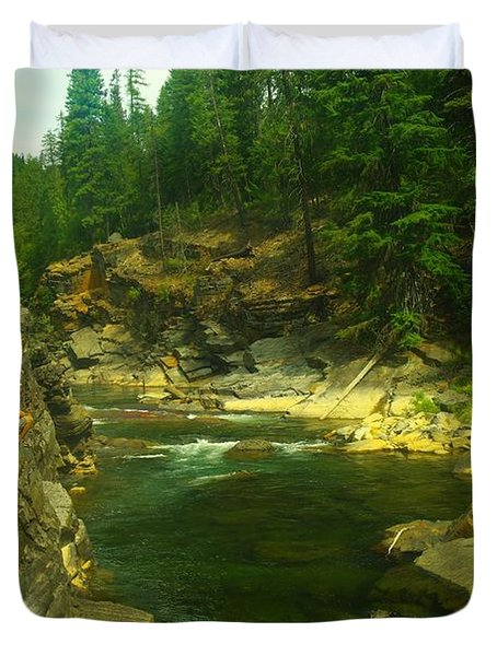 Cliff Over The Yak River Duvet Cover by Jeff Swan