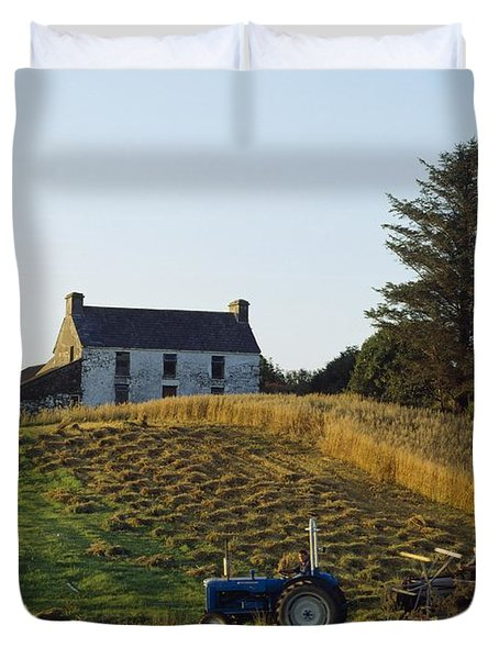 County Cork, Ireland Farmer On Tractor Duvet Cover by Ken Welsh
