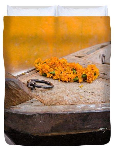 Flowers On Top Of Wooden Canoe Duvet Cover by David DuChemin