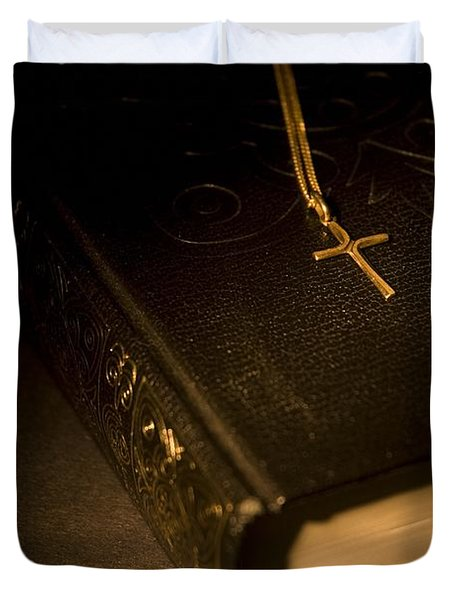 Gold Cross Pendant Resting On A Book Duvet Cover by Philippe Widling