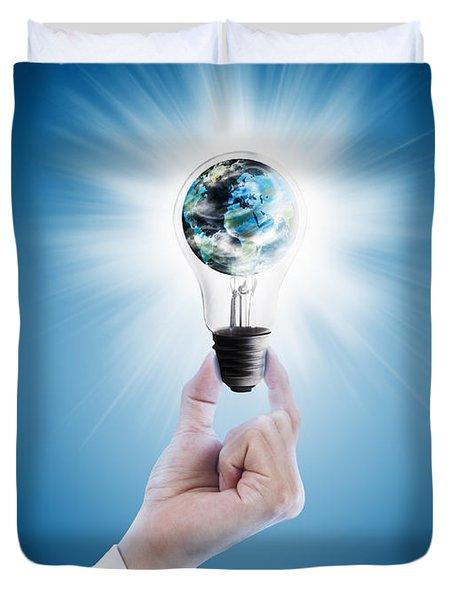 Hand Holding Light Bulb With Globe  Duvet Cover by Setsiri Silapasuwanchai