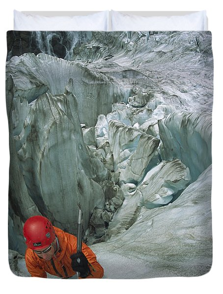 Ice Climber On Steep Ice In Fox Glacier Duvet Cover by Colin Monteath