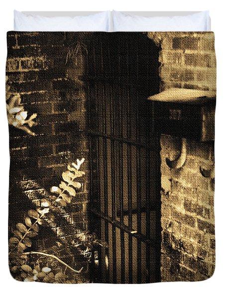 Iron Door Sepia Duvet Cover by Kelly Hazel