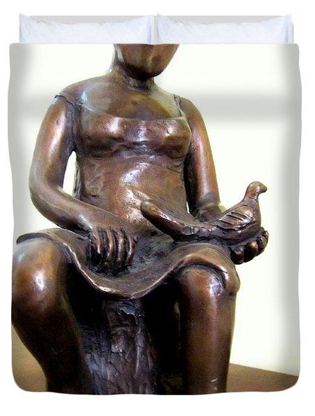 Lady Bird Bronze Sculpture Of A Woman Sitting Holding A Bird With A Dress Face Blurred Strong Legs Duvet Cover by Rachel Hershkovitz