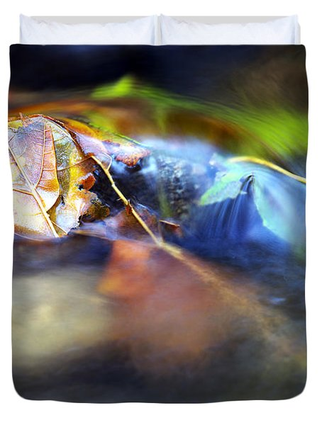 Leaves On Rock In Stream Duvet Cover by Sharon Talson