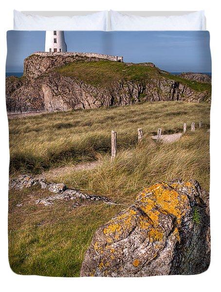 Llanddwyn Rock Duvet Cover by Adrian Evans
