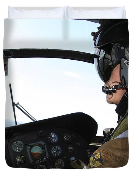 Pilot In The Cockpit Of A Ch-46 Sea Duvet Cover by Daniel Karlsson