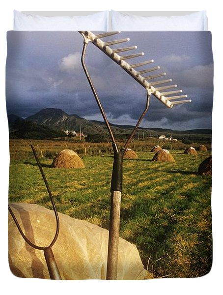 Rake With A Pitchfork On Hay In A Duvet Cover by The Irish Image Collection